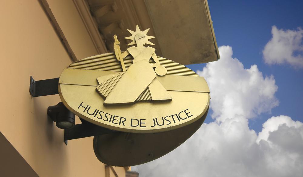 Huissier de justice à l'état des lieux